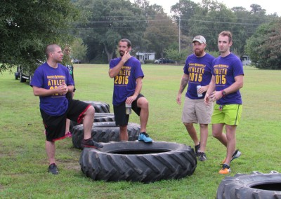 guys standing on tires