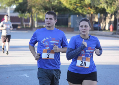 man and woman running side by side
