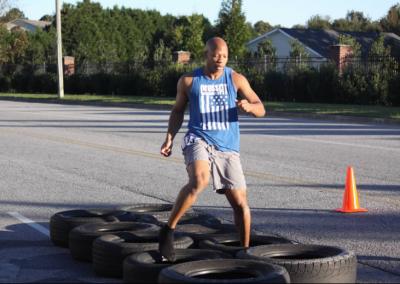 man running through tires