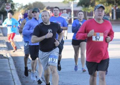 man is black shirt running