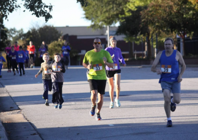 guy in green shirt running